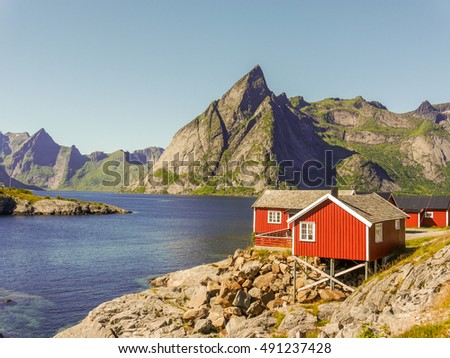 Traditional rorbuer in Hamnoy - Reine on Lofoten Islands, Norway. The beautiful Hamnoy on a sunny summer day