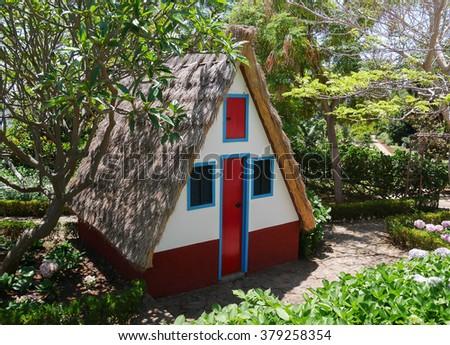 Traditional rural house at Jardim Botanico; Madeira, Portugal. - stock photo