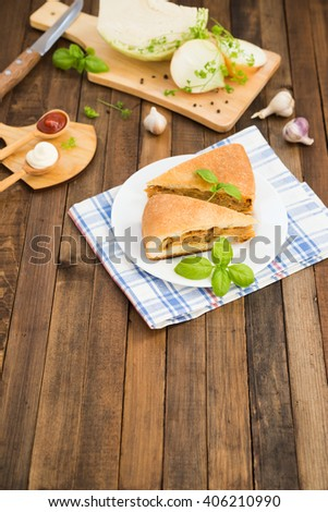 Traditional Russian food. Vegetarian dish. Cabbage pie. Homemade pie with cabbage. Russian cabbage pie. Russian cuisine. - stock photo