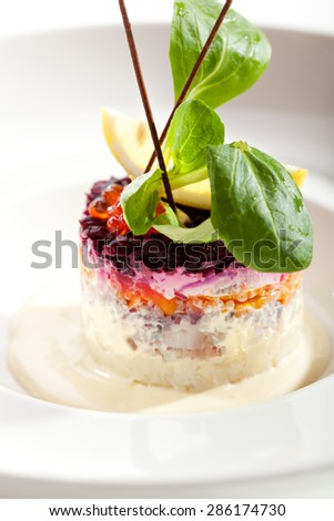 Traditional Russian Herring Salad over White - stock photo
