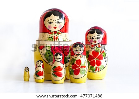 Traditional Russian matryoshka dolls isolated on a white background.