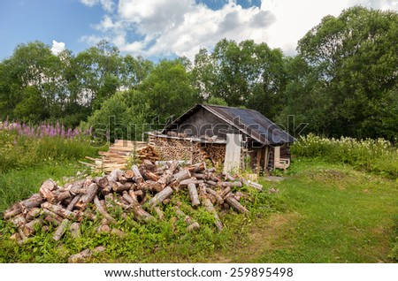 Traditional russian old wooden bath in summer day - stock photo