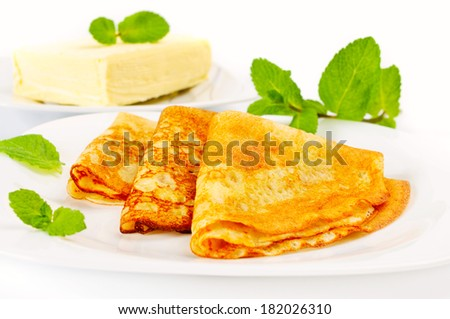 Traditional Russian pancakes with butter