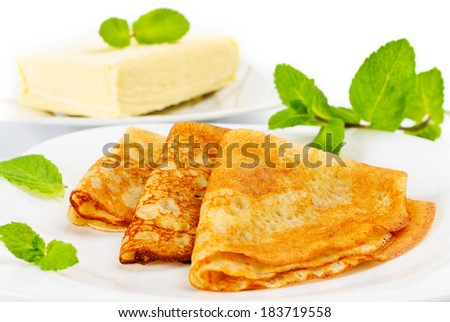 Traditional Russian pancakes with butter - stock photo