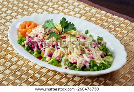 Traditional Russian salad - Dressed herring - stock photo