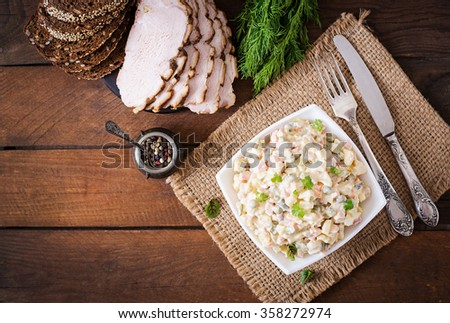"Traditional Russian salad ""Olivier"". Top view - stock photo"