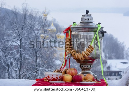 Traditional russian tea with samovar on the background of old Russian city as part of Goden Ring - stock photo
