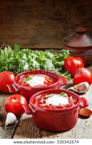 Traditional Russian Ukrainian vegetable soup with cabbage  borsch with sour cream on wooden table