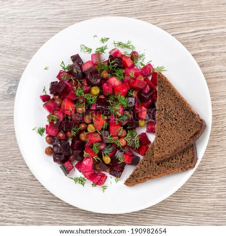traditional Russian vegetable salad with beetroot - vinaigrette, top view, close-up - stock photo