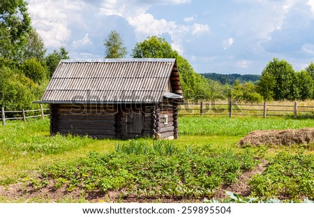 Traditional russian wooden bath in summer day - stock photo