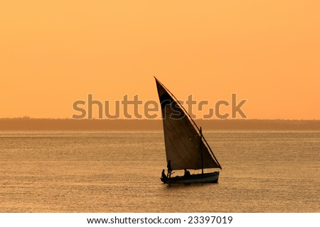 Traditional sail boat (dhow) at sunset, Mozambique, southern Africa - stock photo