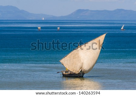 Traditional sailboat near Nosy Be island in northern Madagascar - stock photo