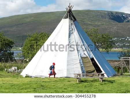 Traditional Sami reindeer-skin tents (lappish yurts) in Tromso  - stock photo