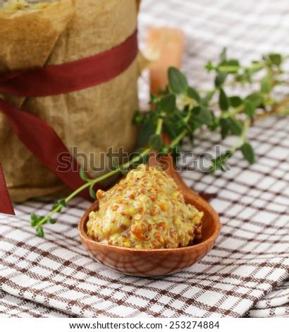 Traditional sauce dijon mustard on a wooden table - stock photo