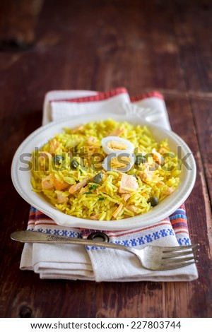 Traditional Scottish dish kedgeree served for breakfast - stock photo