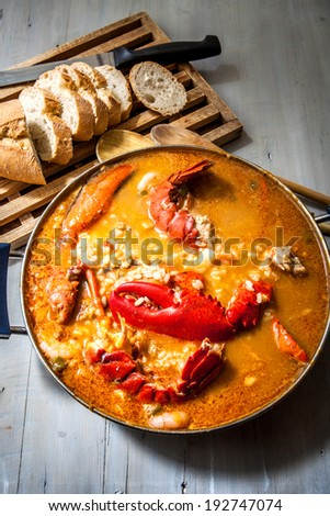 traditional seafood rice with lobster and tomato sauce - stock photo