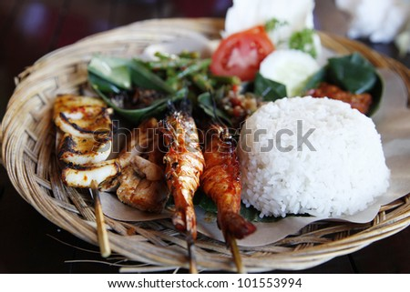 Traditional seafood satay and rice in Bali, Indonesia. - stock photo