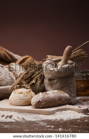 Traditional set of bread, loaves and other ingredients - stock photo