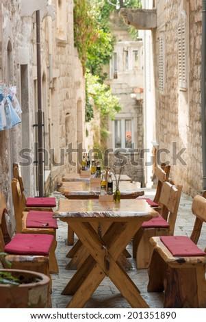 Traditional sidewalk restaurant in Korcula, Croatia - stock photo