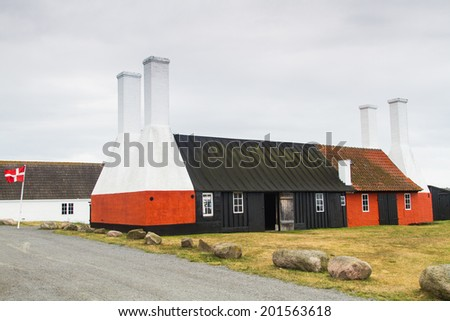 Traditional Smokehouse Chimneys. Bornholm, Denmark. The little village, Hasle, a few kilometer north of the main city on Bornholm, Ronne, is famous for its old 19th century herring smokehouses. - stock photo