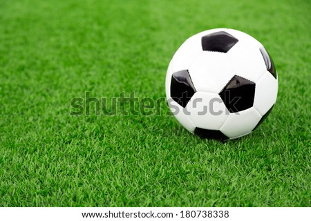 traditional soccer ball on soccer field - stock photo