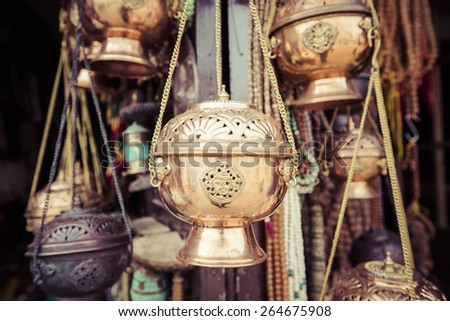 Traditional souvenir in local Nepal market. - stock photo