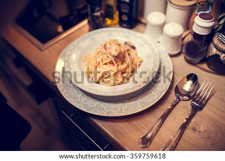 Traditional spaghetti with mussels meat and cream.Mussels with spaghetti in tomato sauce.Pasta with mussel capsicum.Fit diet and healthy food lifestyle.Homemade seafood.Aphrodisiac dinner for date - stock photo