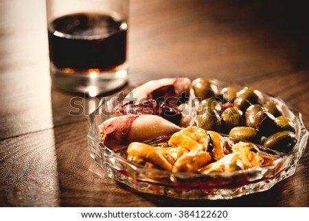Traditional spanish appetizer with vermouth drink, canned food anc chips. - stock photo