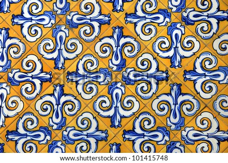 Traditional spanish ceramic tiles in yellow and blue - stock photo