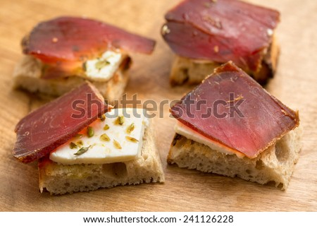 Traditional spanish dish(Tapas)- Salty Dry Tuna (Muxama) - stock photo