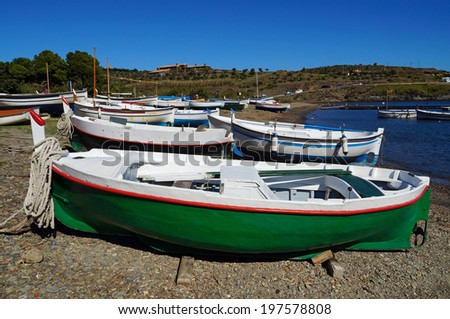 Traditional Spanish fishing boats on a beach of the Mediterranean sea, Cadaques, Costa Brava, Spain - stock photo