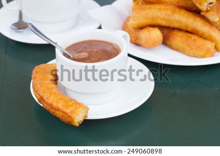 traditional spanish pastry - white cup of chocolate with churros  - stock photo