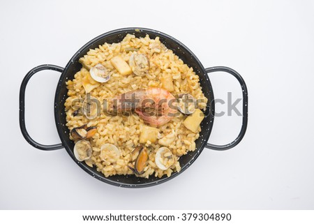 traditional spanish rice - paella isolated on white background - stock photo