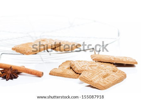 traditional spicy almond spekulatius christmas cookies with a cooling grid cinnamon and aniseed - stock photo