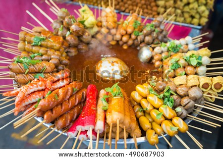 Traditional spicy snacks on thai food open market in Thailand