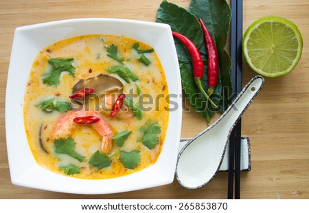Traditional spicy Thai Tom Yam soup - stock photo