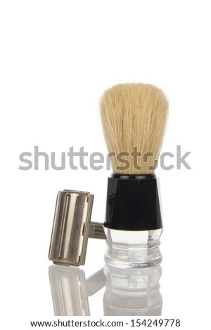 Traditional steel razor with hairy shaving brush isolated in white - stock photo