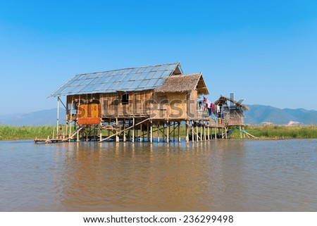 Traditional stilts wooden and bamboo house of Intha people in water on Inle lake, Myanmar (Burma)  - stock photo