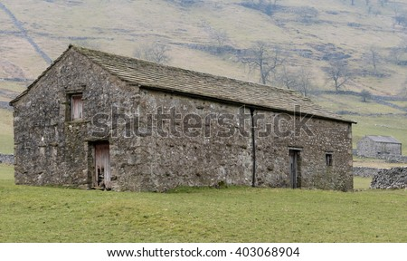 Traditional stone barn on the Dales Way footpath in the Yorkshire Dales, near Kettlewell, Yorkshire, England  - stock photo