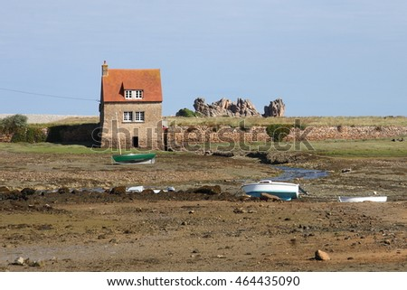 Traditional stone house in french Brittany at low tide