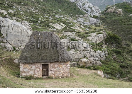 Traditional stone huts with thatched roof in Saliencia Valley, Somiedo Nature Reserve. It is located in the central area of the Cantabrian Mountains in the Principality of Asturias in northern Spain - stock photo