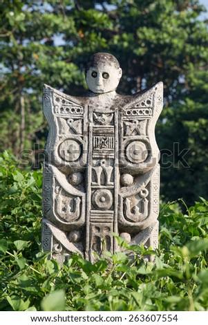 Traditional stone sculpture in garden . Island Bali, Ubud, Indonesia - stock photo
