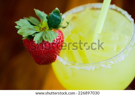 Traditional strawberry margarita with fruit on top. - stock photo