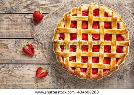 Traditional strawberry pie tart cake sweet baked pastry food on rustic wooden table background - stock photo
