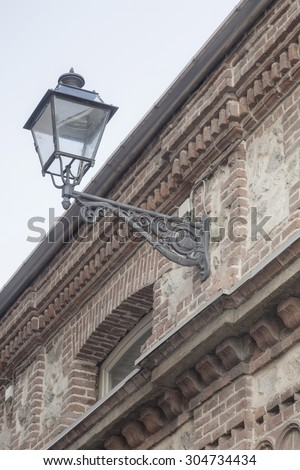 Traditional street lighting in Cuneo - stock photo