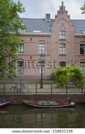 traditional street scene in amsterdam holland netherlands - stock photo