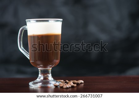 traditional strong irish coffee on wooden bar with coffee beans