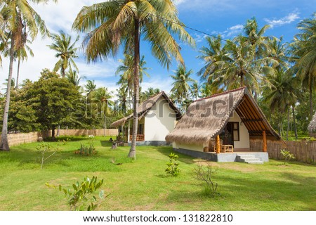 Traditional style accommodation on tropical island - stock photo