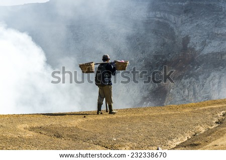 traditional sulphur worker at ijen volcano Indonesia - stock photo