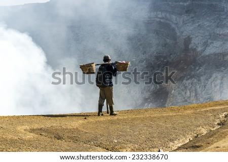 traditional sulphur worker at ijen volcano Indonesia - stock photo